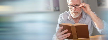 Mature man reading a book Royalty Free Stock Photo