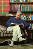 Mature man reading book Royalty Free Stock Images