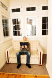 Mature man reading a book at home Stock Image