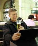 Mature man reading menu card Stock Photo