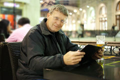 Mature man reading menu card Stock Photo