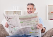 Mature man reading newspaper Stock Photography