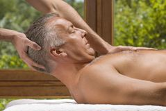 A mature man receiving a massage royalty free stock images