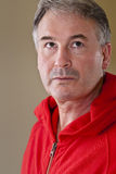 Mature man in red sweater Royalty Free Stock Image