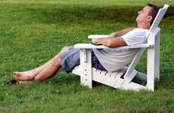 Mature man relaxing. On a summer day stock photos