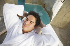 Mature Man Relaxing On Chair. High angle view of a mature men relaxing on chair Stock Photo