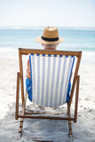 Mature man relaxing on a deck chair Royalty Free Stock Images