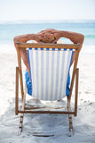 Mature man relaxing on a deck chair Stock Photo