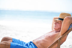 Mature man relaxing on a deck chair Stock Photography