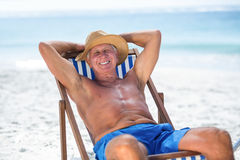 Mature man relaxing on a deck chair Royalty Free Stock Photos