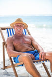 Mature man relaxing on a deck chair Stock Image