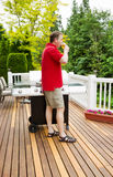 Mature Man relaxing by drinking beer on outdoor patio Royalty Free Stock Photo