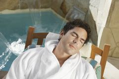 Mature Man Relaxing On Spa Chair. High angle view of a mature men relaxing on spa chair Stock Image