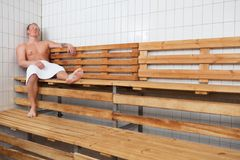 Mature man relaxing in steam room Stock Photo