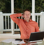 Mature man resting at work Stock Photography