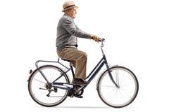 Mature man riding a bicycle royalty free stock photos