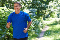 Mature Man Running Outdoors In Countryside. Mature Man Runs Outdoors In Countryside stock photography