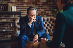 Mature man in sad emotions Stock Photos