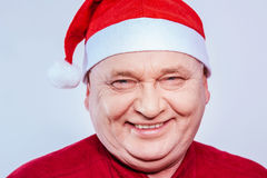 Mature man in Santa Claus hat Stock Photo