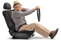 Mature man seated in a car seat experiencing neck pain Stock Image
