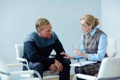 Mature Man Seeking Psychological Help Stock Photo