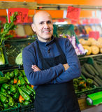 Mature man selling veggies Stock Photography