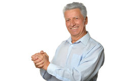 Mature man with shaking hands stock photo