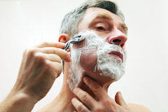 Mature man shaving Stock Photos