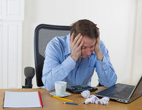 Mature man showing frustration while working Stock Photos