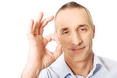 Mature man showing perfect sign Royalty Free Stock Photography