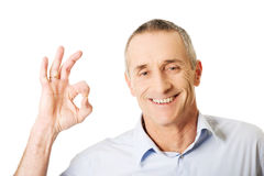Mature man showing perfect sign Royalty Free Stock Image