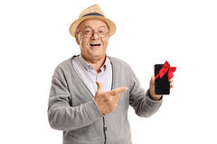 Mature man showing a phone wrapped with red ribbon Royalty Free Stock Images