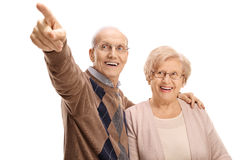 Mature man showing something in the distance to mature woman Royalty Free Stock Photo