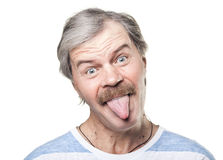 Mature man shows tongue isolated on white Stock Photos