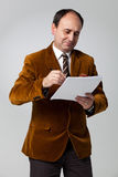 Mature Man Signing a Document Stock Photography