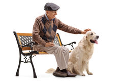 Mature man sitting on a bench and petting his dog Royalty Free Stock Image