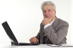 Mature man sitting at the computer Stock Images