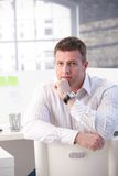 Mature man sitting in office thinking Stock Images