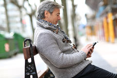 Mature man sitting on public bench Royalty Free Stock Photos