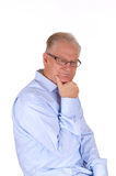 Mature man sitting and thinking. Royalty Free Stock Images