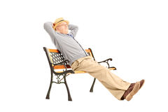 Mature man sitting on a wooden bench. Isolated on white background stock photo