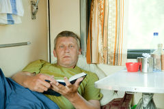 Mature man  in sleeper train Stock Photos