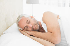 Mature man sleeping in bed Royalty Free Stock Photos