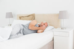 Mature man sleeping in bed Stock Photography