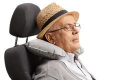 Mature man sleeping on a seat with a neck pillow. Isolated on white background Stock Images