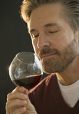 Mature Man Smelling Red Wine Stock Photos