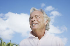 Mature Man Smiling Against Sky Royalty Free Stock Photo