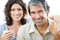 Mature man smiling with his wife at the back Stock Photos