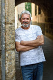 Mature man smiling looking at camera in urban background Royalty Free Stock Images