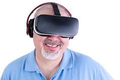 Mature man smiling with virtual reality headset Stock Photo